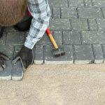 paver laying driveway pavement out of concrete pavement blocks
